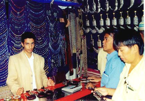 Scouring for souvenirs in a souk (market), Sana'a, Yemen, 2008